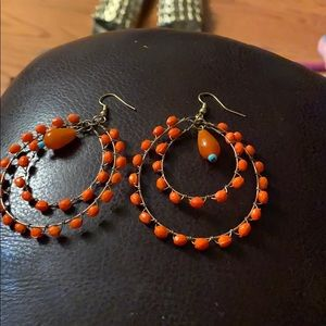 Orange earrings and gold toned french hooks